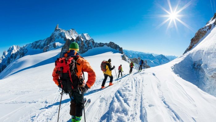 group of skiers in french alps on a sunny day