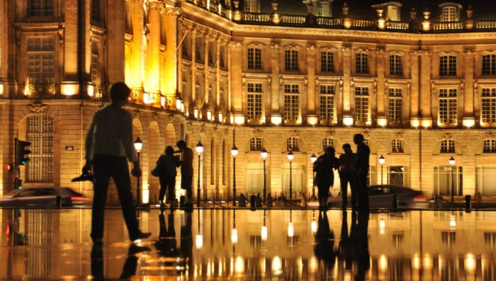people in bordeaux at night, france
