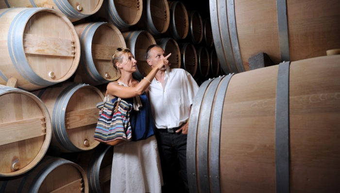 couple in winery, France