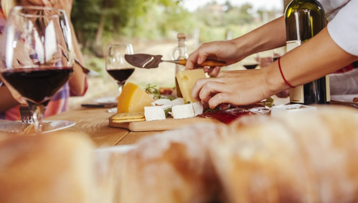 people eating wine and cheese