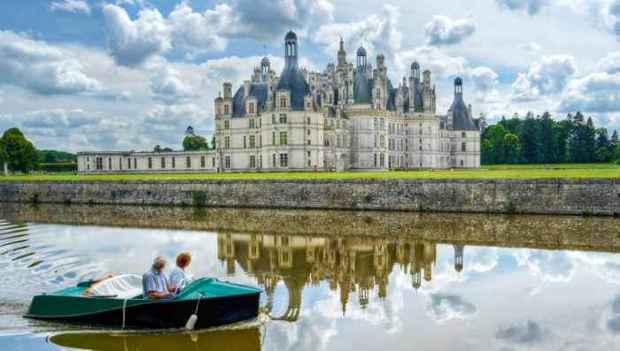 Couple in boat near french castle in Loire