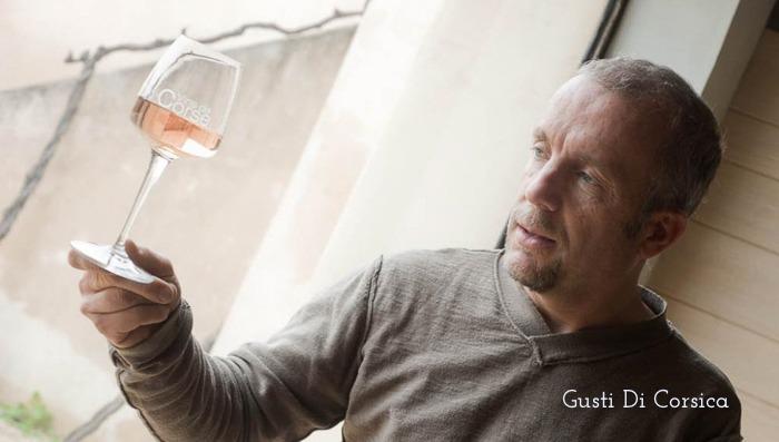 Men holding glass of wine