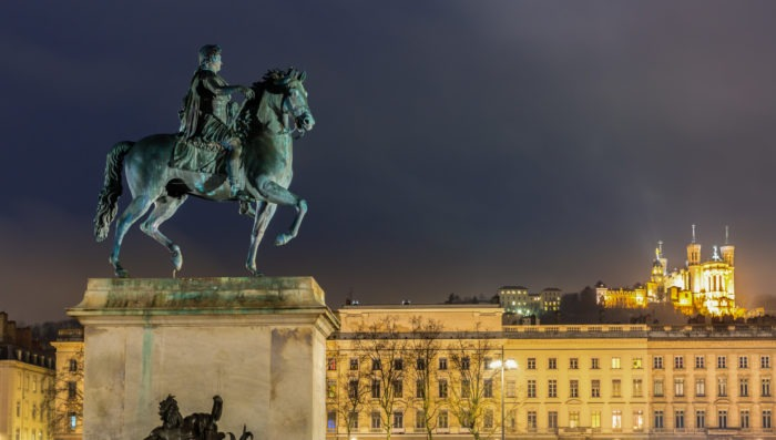 statue in lyon's bellcour place at night