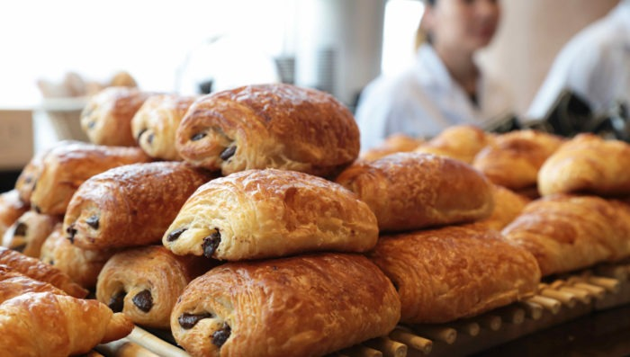 pile of pain au chocolate pasteries in french bakery